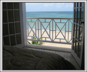 The Bedroom Looks Out On The Caribbean - Beach Bliss Condominium