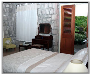 The Master Bedroom Receives Tropical Breezes - Nevis Holiday Homes