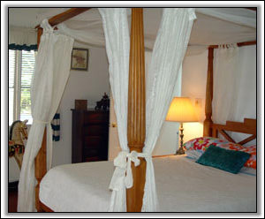 Caribbean Style Linens Adorn The Bed - Nevis Property