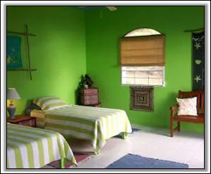 This Bedroom In Caribbean Colours - Frye House Villa Holiday Homes