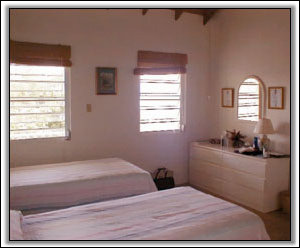 The Bedroom In West Indian Style - Nevis Holiday Homes