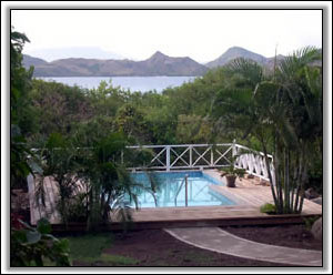 The Pool Has Views Of St. Kitts And The Sea - Holiday Houses